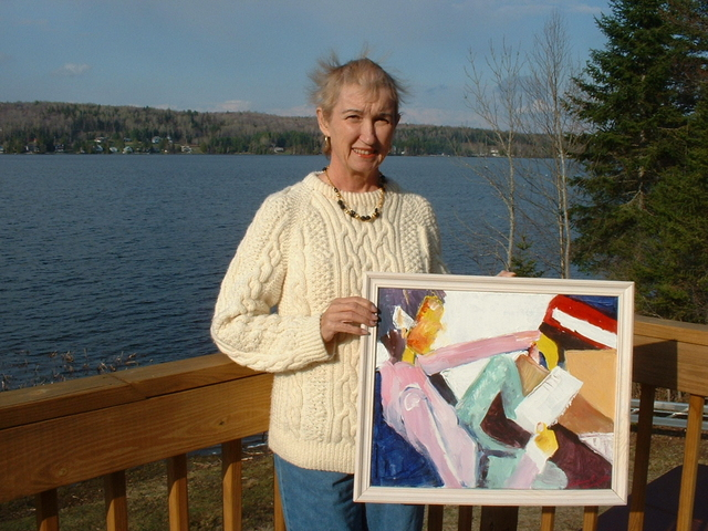 Patricia Klinefelter Holding a Painting